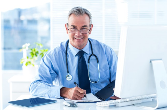Physician working at computer