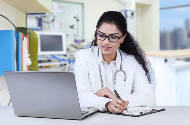 Physician working at a computer
