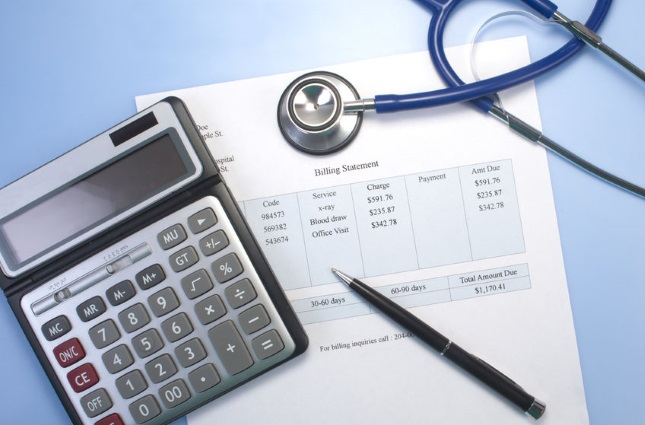 Stethoscope, calculator, and invoice