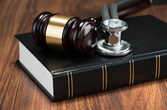 Gavel, stethoscope, and law book