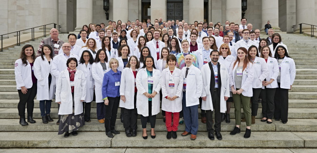 physicians standing on steps of capitol
