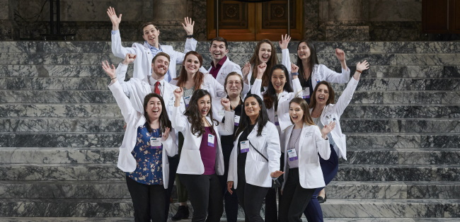 group of medical students standing on steps